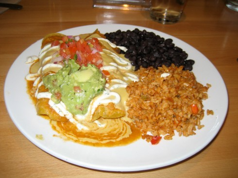 """Michael's dish was """"El Bandito Rojo""""  It was like an enchiladas with beans and rice."""